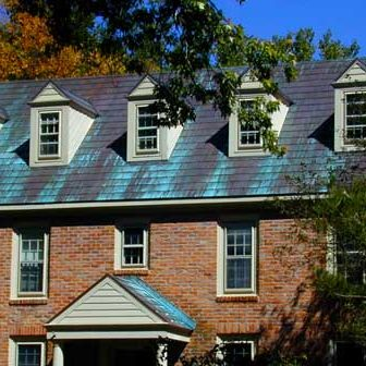 copper shingle roof with blue green patina